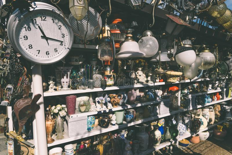 Flea market goods on display. Como, Italy - September 30th, 2017: Antiques for sale to bargain hunters in a shop in Italy royalty free stock photo