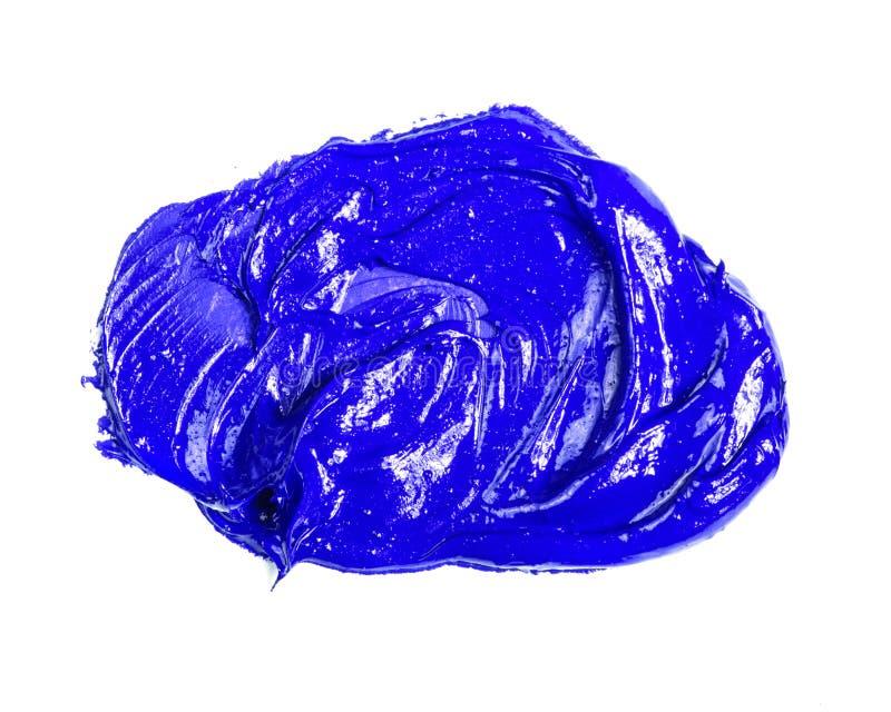 Fleck der blauen ?lfarbe auf einem wei?en stockbilder