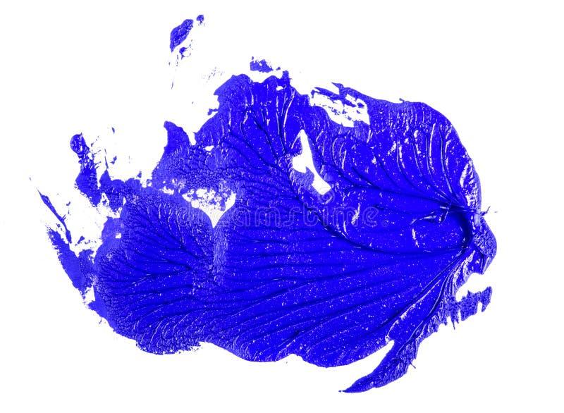 Fleck der blauen ?lfarbe auf einem wei?en stockbild