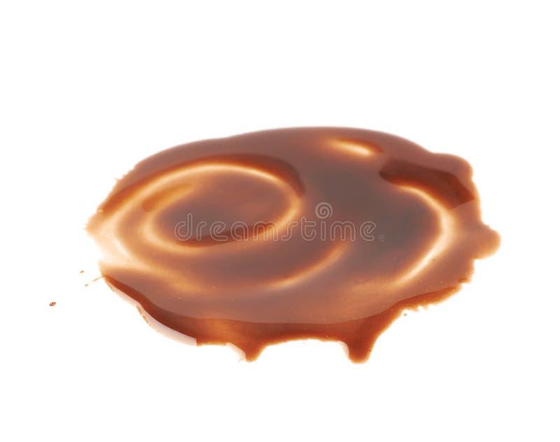 Fleckpfütze der heißen Schokolade lokalisiert stockfotografie