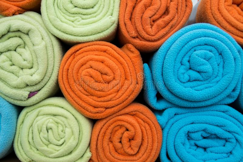 Fleece blankets. Pile of colorful blankets made from fleece, all rolled up stock photos