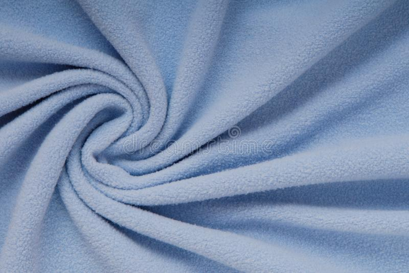 Fleece textile, beautiful shape, blue cloth, soft material, text royalty free stock images