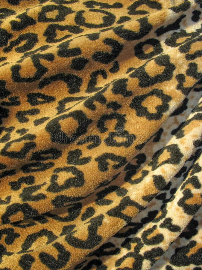 Fleecy Brown Draped Leopard Skin Fabric Royalty Free Stock Photos