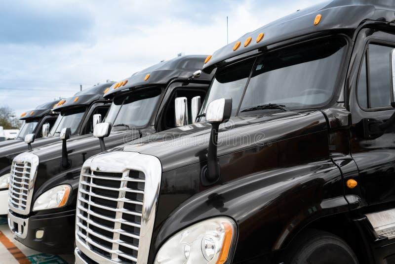 Fleet of black 18 wheeler semi trucks stock image
