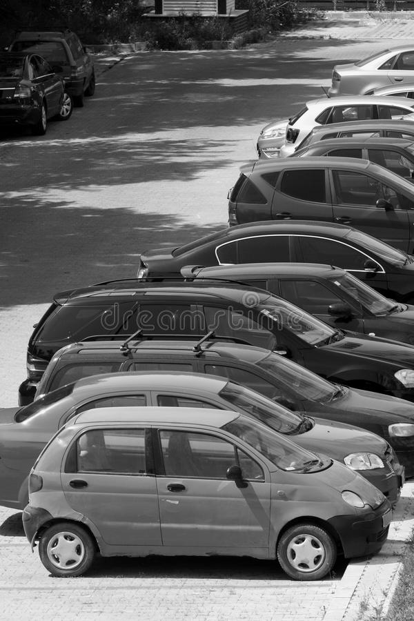 Fleet of cars. A long line of cars outdoors stock photography
