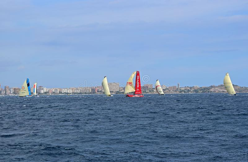 The Fleet Rounding A Buoy Volvo Ocean Race Alicante 2017. Beating to and running with the wind under spinnakers or code 0 during the first leg of the round the stock photo