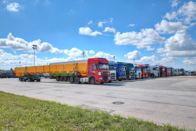 Fleet of semi trailer lorries in courtyard of logistics park. St. Petersburg, Russia - July 27, 2017: Fleet of trucks, a lot of trucks parked in the yard of a stock photography