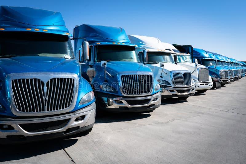 Fleet of semi truck 18 wheeler trucks. Fleet of tractor trailer trucks 18 wheelers room for text copy stock images