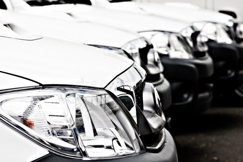 Fleet of White Cars and trucks