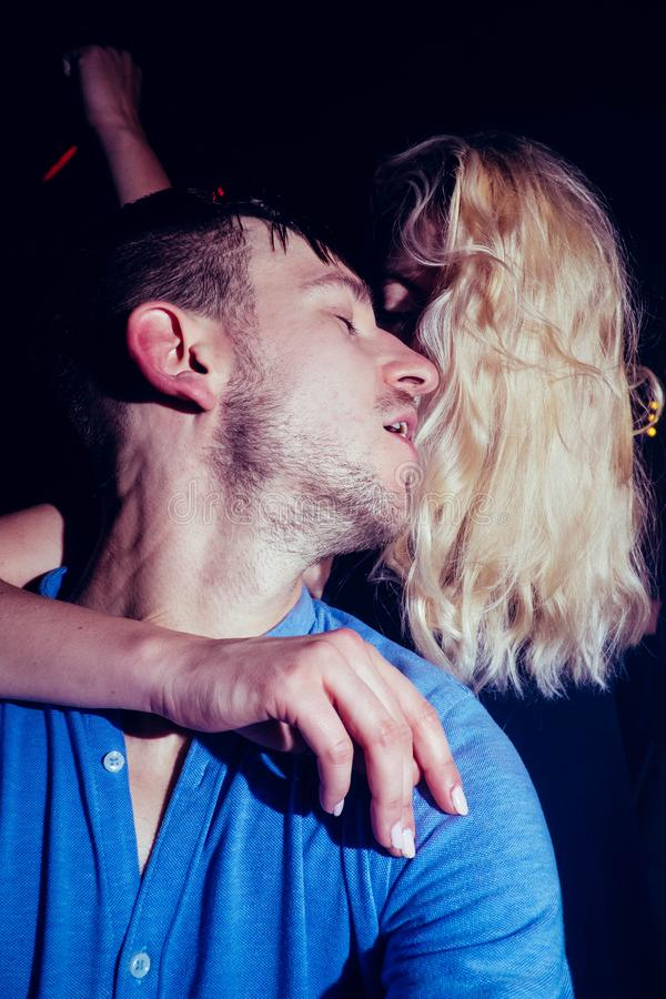 A fleeting moment of intimacy of hidden kiss royalty free stock photo