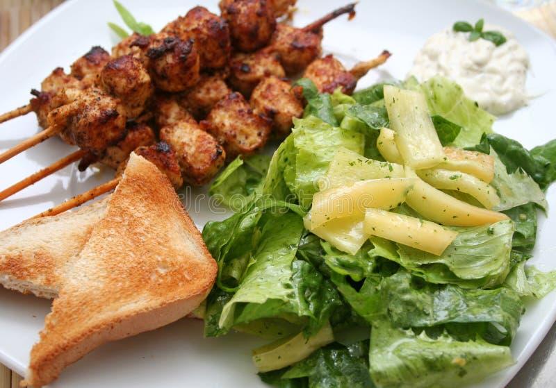 Fleisch und Salat stockbild