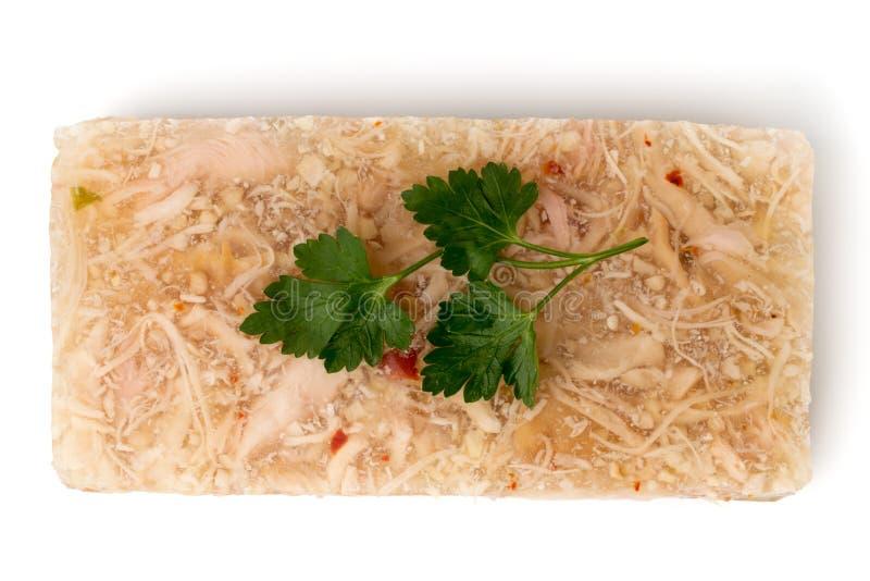 Fleischgelee mit Petersilie verlässt auf einem weißen Hintergrund lizenzfreie stockbilder