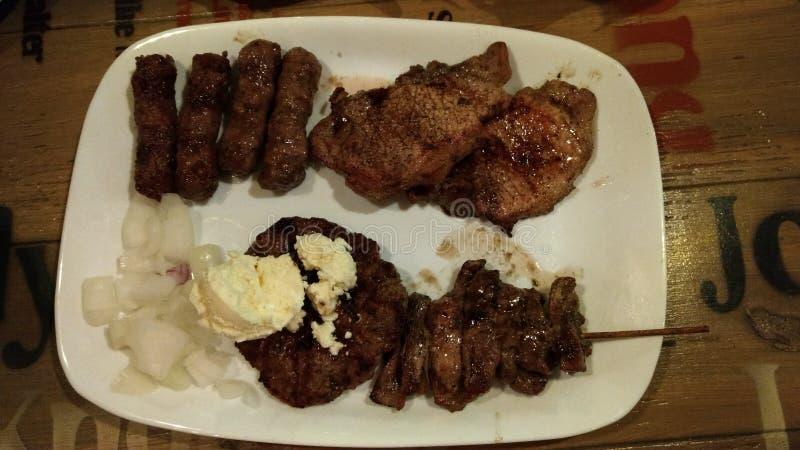 Fleischiges Fleisch mit Soße lizenzfreie stockbilder