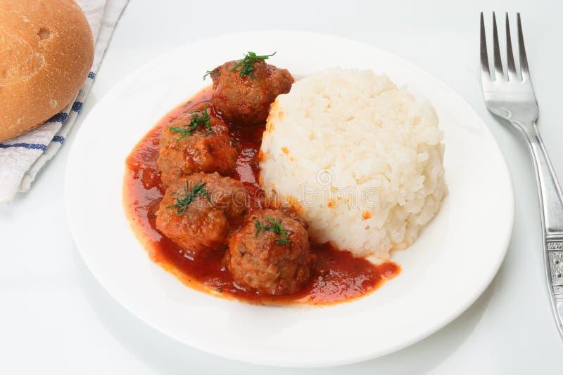 Fleischklöschen mit Reis lizenzfreie stockbilder