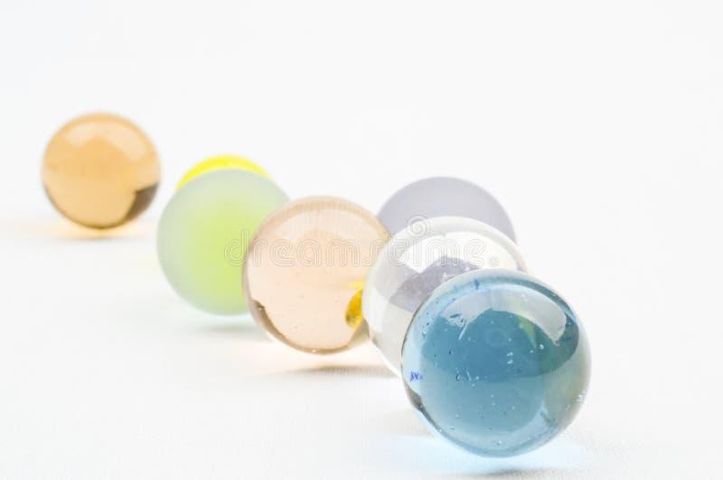 Flera exponeringsglasmarmor i pastellfärgade färger fotografering för bildbyråer