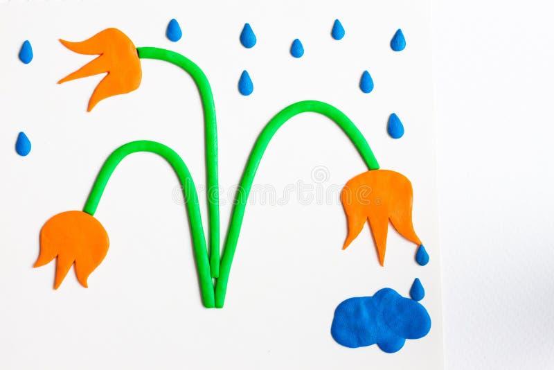 Flera härliga blommor av orange färg göras av plasticine på en vit bakgrund royaltyfria foton