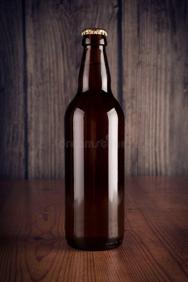 Fles bier stock afbeelding