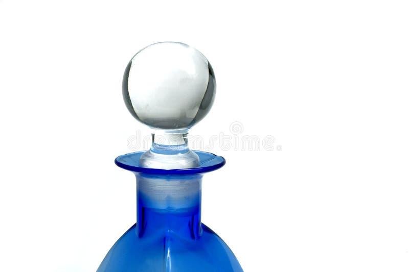 Fles in blauw royalty-vrije stock afbeelding
