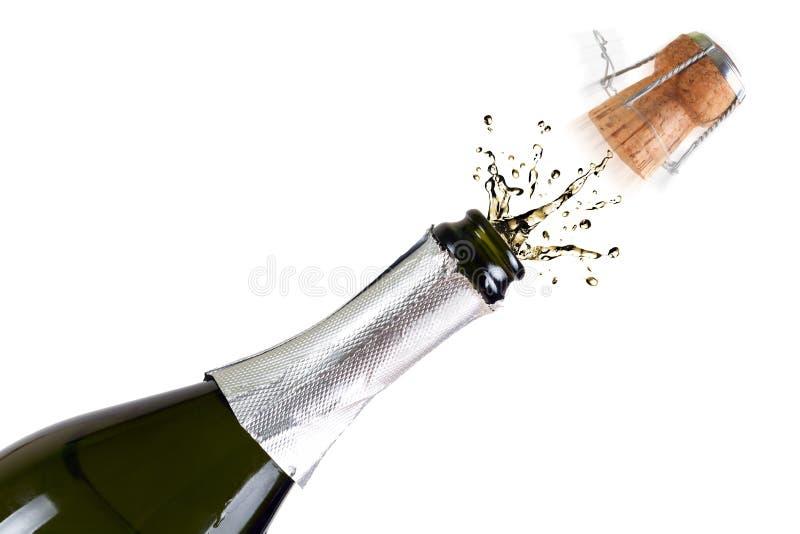 Fles champagne met plonsen stock afbeelding