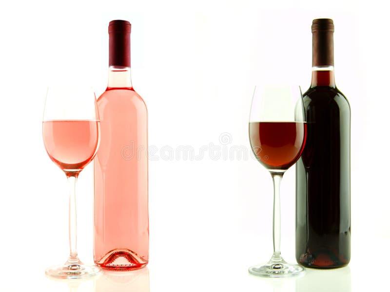 Fles en glas roze en rode geïsoleerde wijn stock afbeeldingen