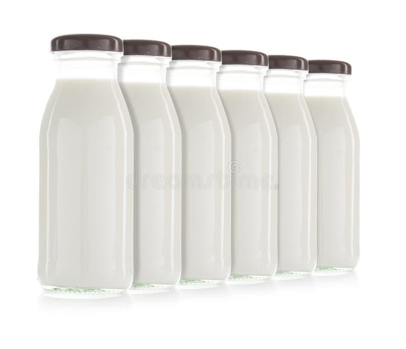 Fles geïsoleerde melk stock foto's