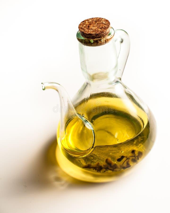 Fles, karaf, met olijfolie royalty-vrije stock afbeeldingen