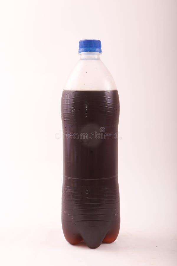 Fles kola stock afbeeldingen