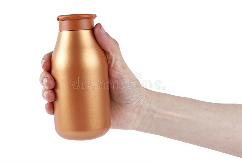 Fles met in hand shampoo stock afbeelding