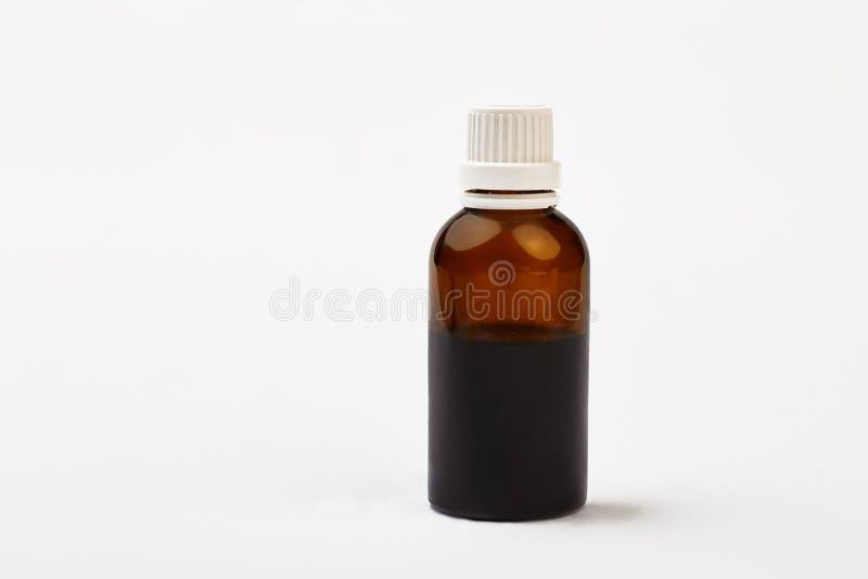 Fles met hoeststroop stock foto's