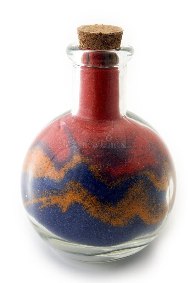 Fles met kleurrijk zand royalty-vrije stock afbeeldingen