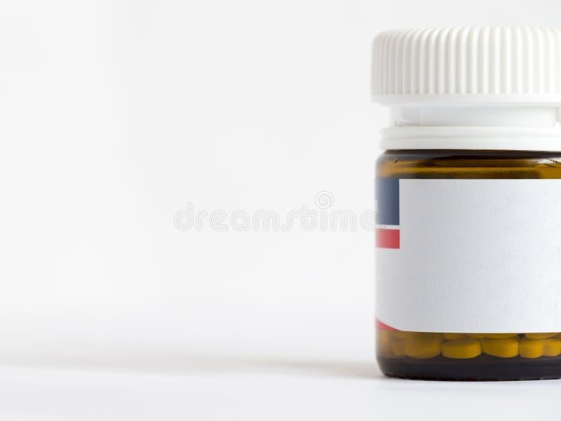 Fles met pillen royalty-vrije stock afbeeldingen
