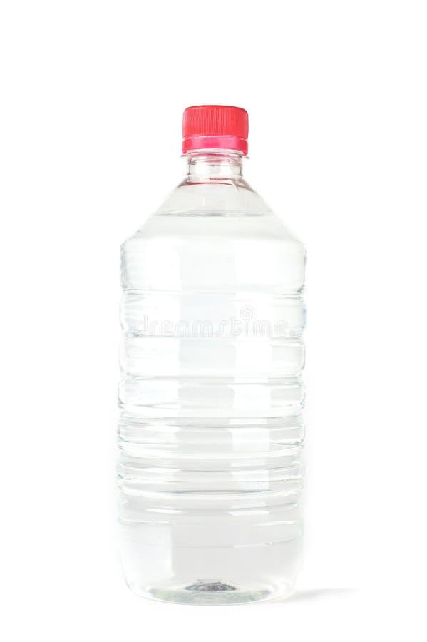 Fles met zuiver water stock foto's