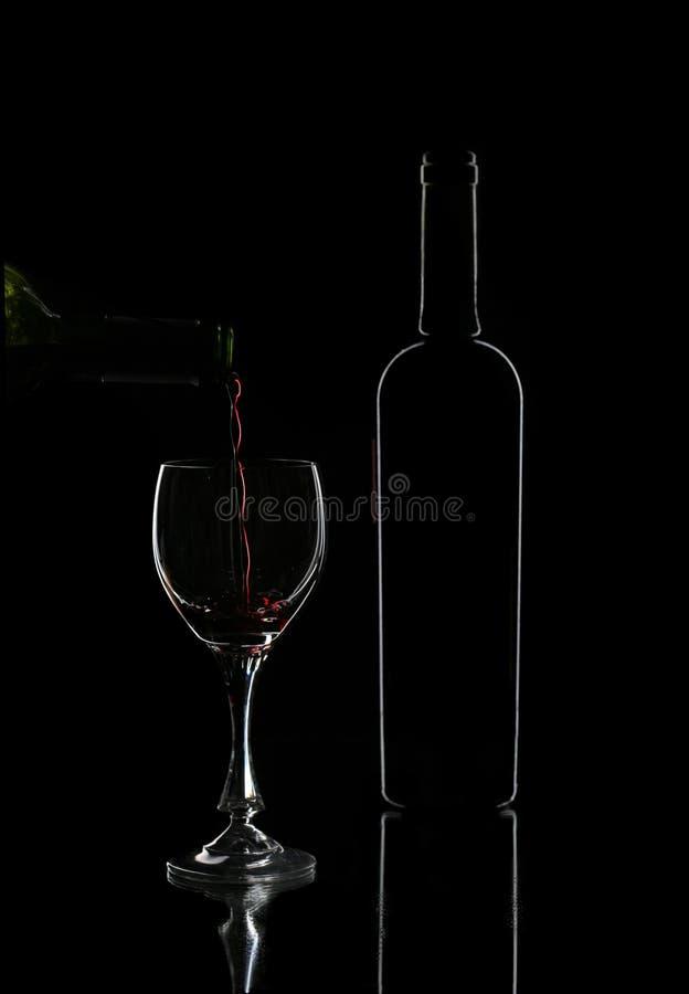 Fles rode wijn stock afbeelding