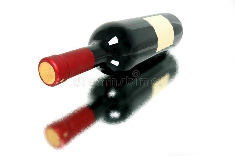 Fles van fijnste rode wijnstok stock foto
