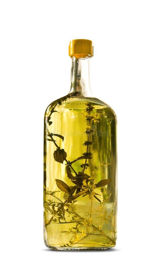 Fles van kruidrakia stock foto