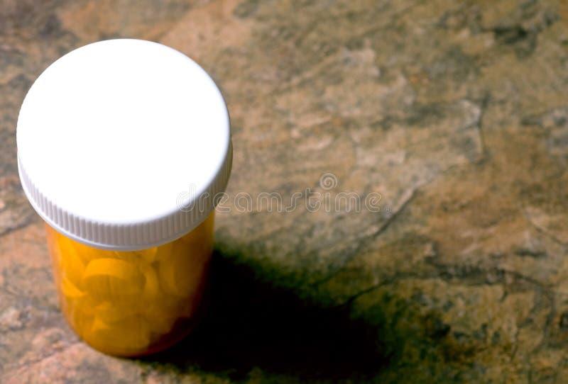Fles van Pillen op Marmeren Teller stock foto's
