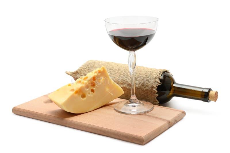 Fles van wijn en kaas royalty-vrije stock foto's