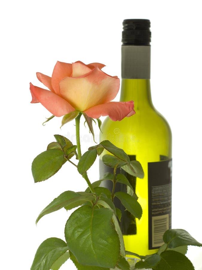 Fles wijn met een roze stam stock afbeelding