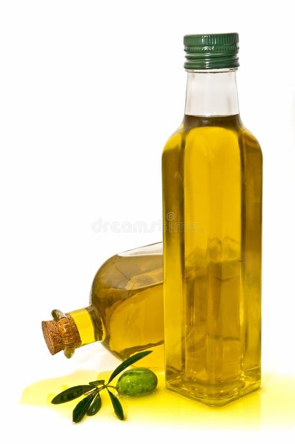 Flessen en kruiken met olijfolie royalty-vrije stock foto's