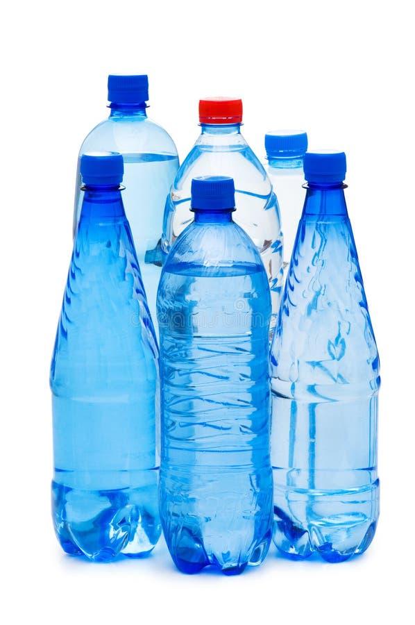 Flessen geïsoleerdh water royalty-vrije stock foto's