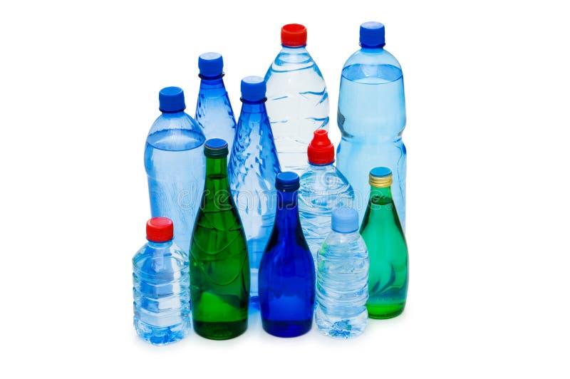 Flessen geïsoleerdi water royalty-vrije stock afbeelding