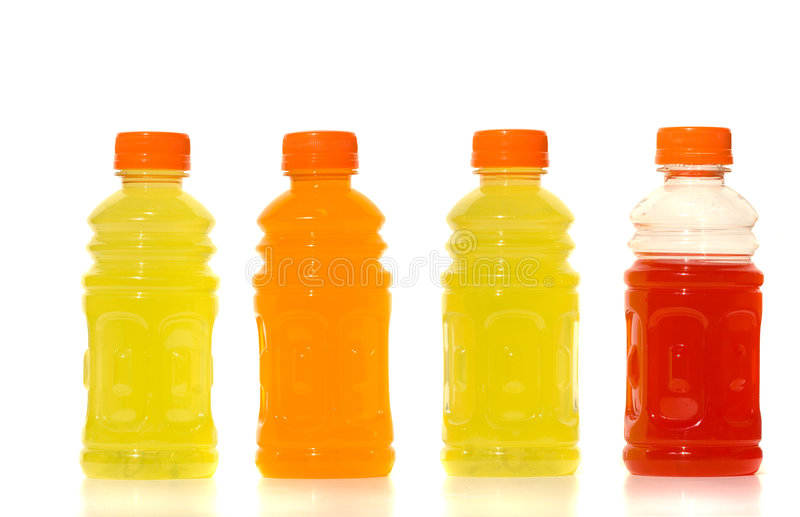 Flessen Limonade tegen witte achtergrond royalty-vrije stock afbeelding