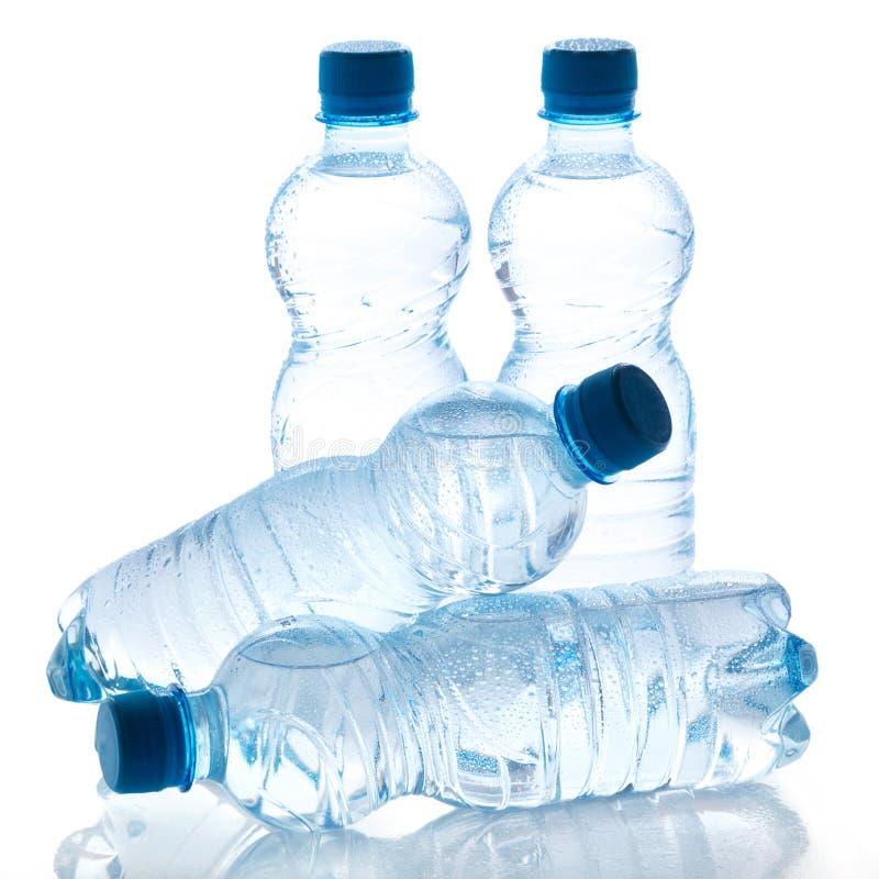 Flessen met water stock foto's