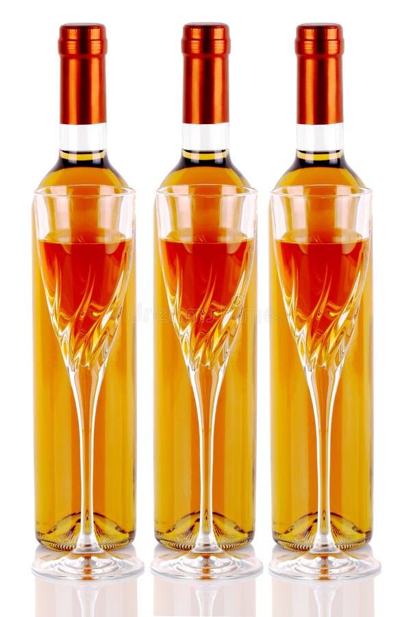 Flessen passitowijn met wijnglazen royalty-vrije stock afbeelding