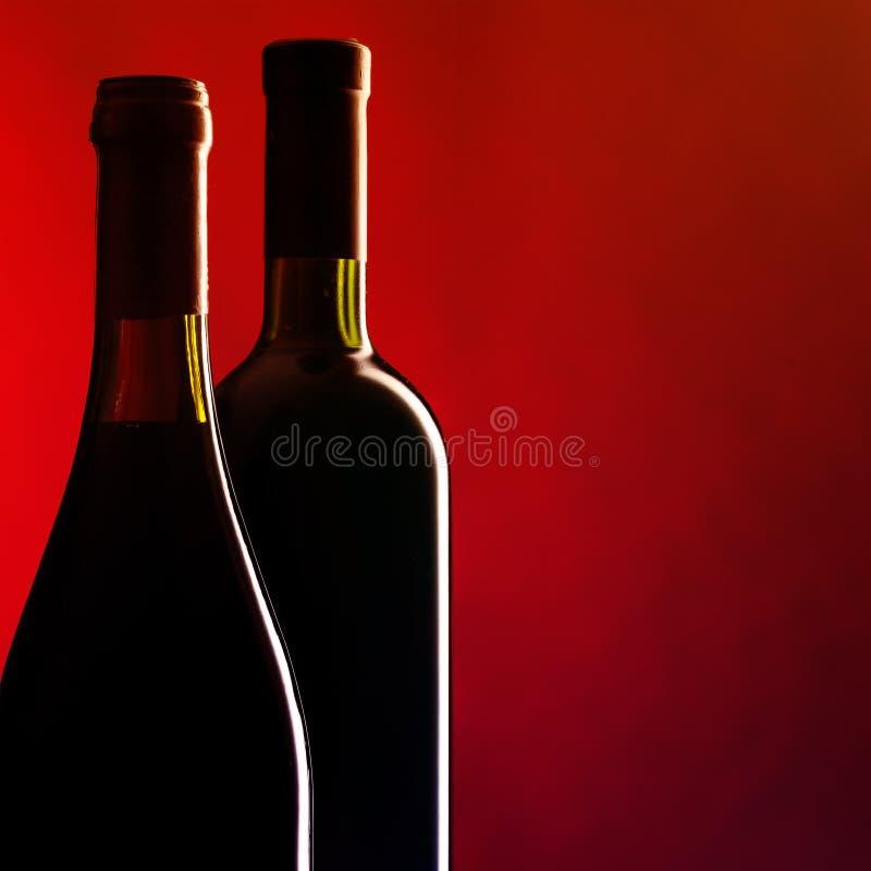 Flessen rode wijn royalty-vrije stock afbeeldingen