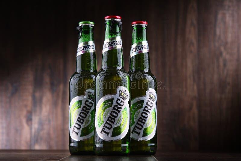 Flessen Tuborg-Bier stock foto's