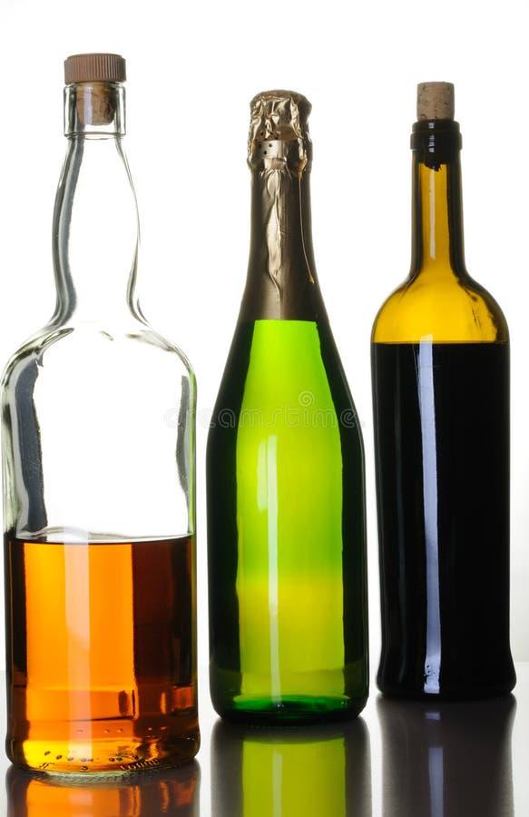 Flessen van alcoholdranken stock fotografie