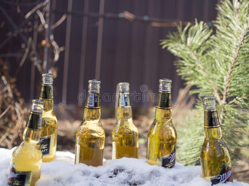 Flessen van het globale merk van het Molenaarbier royalty-vrije stock fotografie