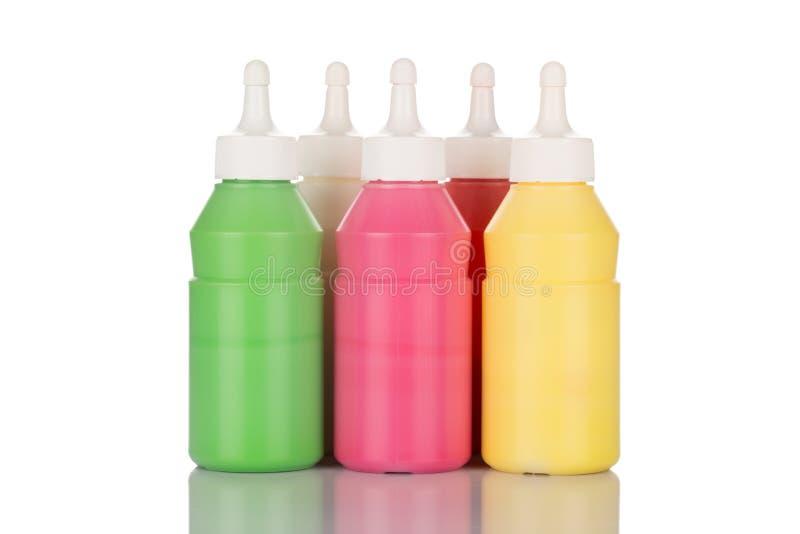 Flessen van verf stock foto