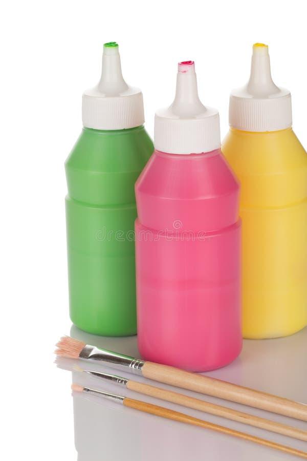 Flessen van verf en potloden royalty-vrije stock afbeelding